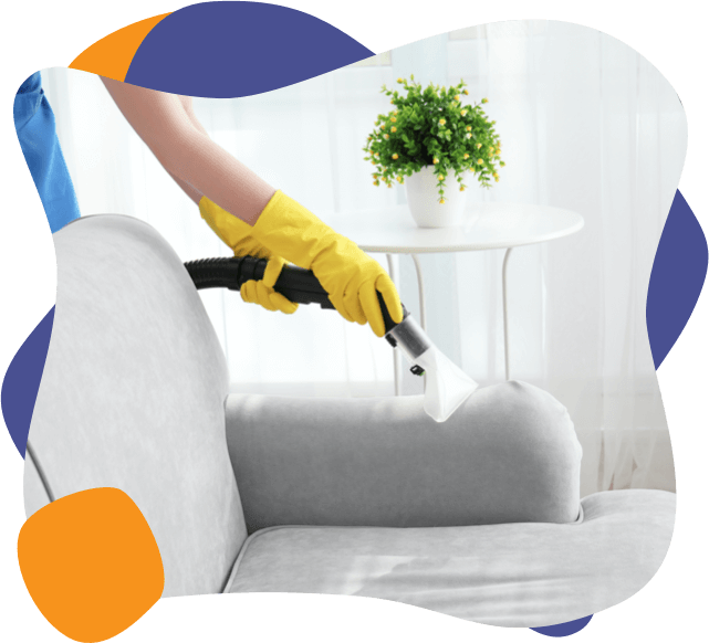 An enviropure home cleaning specialist cleans a sofa