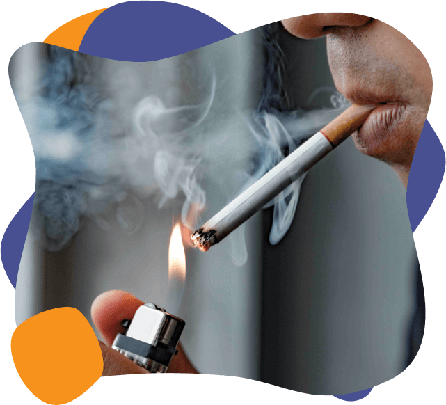 someone lighting a cigarette indoors and smoking it